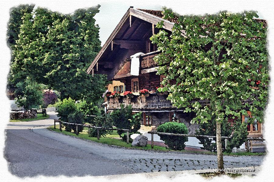 Ehemaliges Bauernhaus (zweigeschossiger Blockbau mit Flachsatteldach) im Lindenschmitweg in Waakirchen.